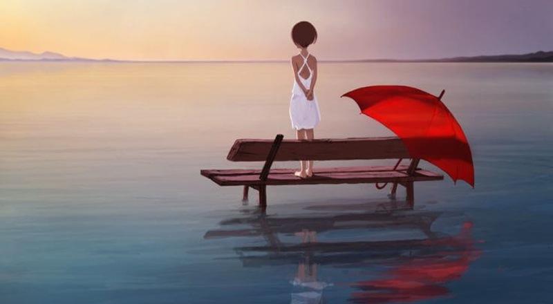Una niña sobre un banquito mirando hacia el horizonte